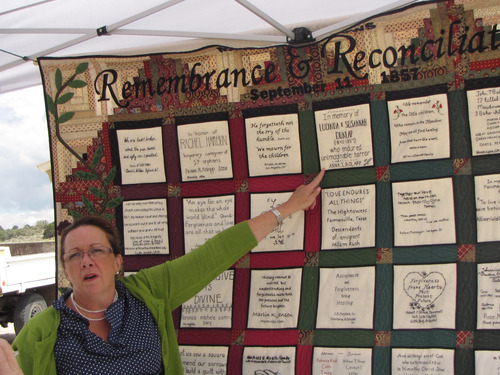 Mark Havnes |  The Salt lake Tribune Anna T. Rolaopp points on Saturday to a Remembrance and Reconciliation quilt containing names of victims of Mountain Meadows Massacre on Sept. 11 1857. The quilt was made to help bring together ancestors of the victims and perpetrators of the massacre. The quilt will be shown at Southern Utah University, and a similar quilt is on display in Arkansas.