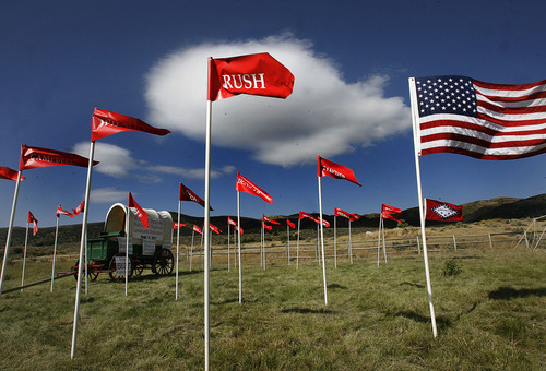 Scott Sommerdorf  |  The Salt Lake Tribune              Flag bearing names of those families who had family members killed in the Mountain Meadows massacre fly at the site, Sunday, September 11, 2011.