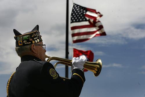 Scott Sommerdorf  |  The Salt Lake Tribune              Korean War veteran Lloyd M. Berdsley plays taps at the Mountain Meadows massacre site, Sunday, September 11, 2011.