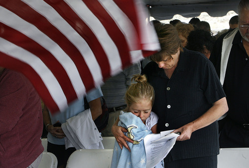 Scott Sommerdorf  |  The Salt Lake Tribune              Becky Shields of Hurricane, and her 8 year old daughter Megan during a mement of silence at the Mountain Meadows massacre site, Sunday, September 11, 2011.