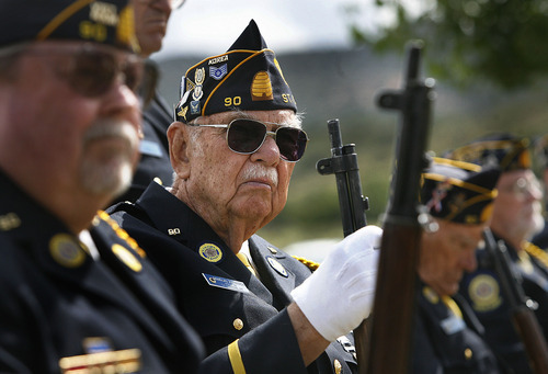 Scott Sommerdorf  |  The Salt Lake Tribune              Veteran Douglas Johansen listens during the Mountain Meadows massacre site ceremony, Sunday, September 11, 2011.