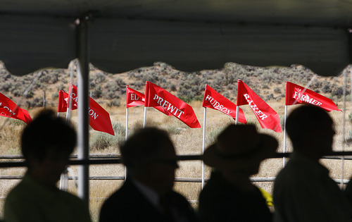 Scott Sommerdorf  |  The Salt Lake Tribune              Flags bearing the names of families who had members killed in the Mountain Meadows massacre 154 years ago, flew outside the tent in which the ceremony was held, Sunday, Sept. 11, 2011.