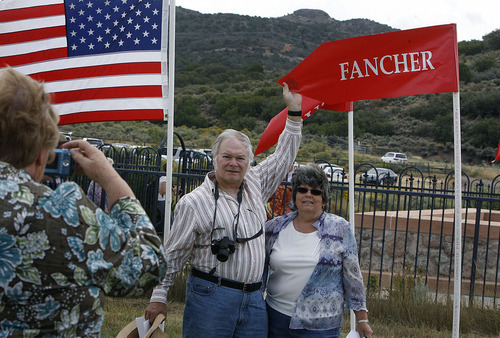 Scott Sommerdorf  |  The Salt Lake Tribune              Peggy Crabtree and her husband Doug are photographed next to the Fancher flag at the Mountain Meadows massacre site, Sunday, September 11, 2011. Peggy is the great granddaughter of James Polk Fancher.