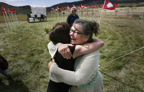 Scott Sommerdorf  |  The Salt Lake Tribune              Karen Fancher (right) hugs Dr. Shannon Novak, a forensic expert who helped to prove aspects of the massacre through examination of victim's remains. They met after the ceremony at the Mountain Meadows massacre site, Sunday, September 11, 2011.