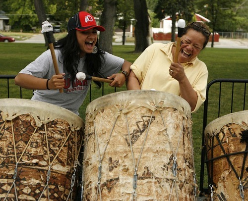 Trent Nelson  |  The Salt Lake Tribune Leta Fauolo, left, and Fahina Pasi share a laugh Saturday while playing drums at the Friendly Island Festival held at the Jordan Peace Park.
