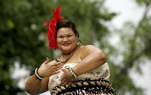 Trent Nelson  |  The Salt Lake Tribune Meleana Fa performs a traditional dance, Tauolunga, on Saturday at the Friendly Island Festival held at the Jordan Peace Park.