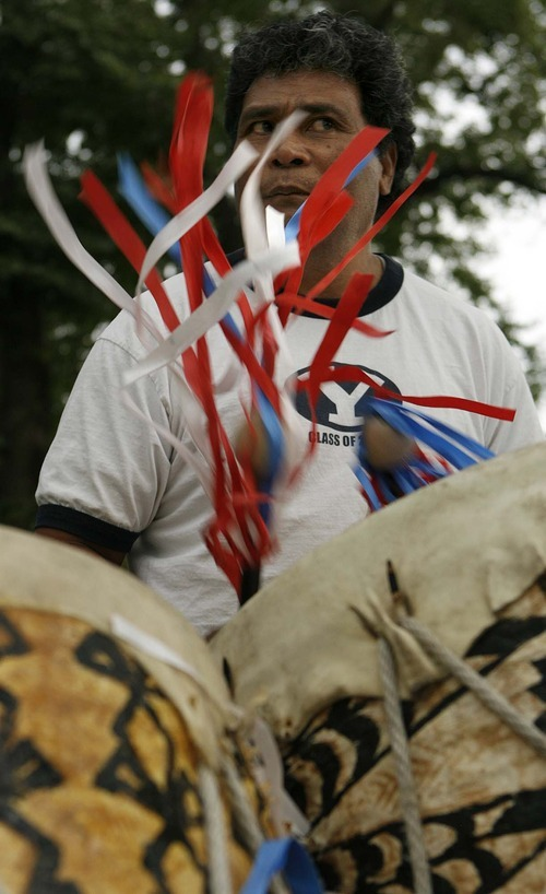 Trent Nelson  |  The Salt Lake Tribune Sifa Kolo leads a drumming competition Saturday at the Friendly Island Festival held at the Jordan Peace Park.