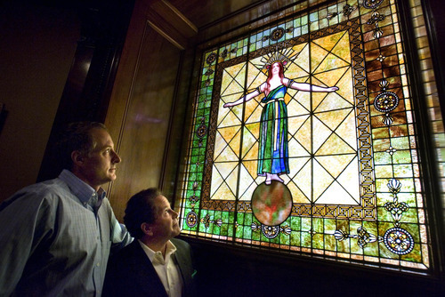 Paul Fraughton  |  The Salt Lake Tribune  Shawn Fletcher and Philip McCarthey look at the stained glass window that was original to the McCune Mansion. The window was missing for years, discovered in California, purchased at auction and replaced in its original location at the mansion.   Tuesday, September 13, 2011