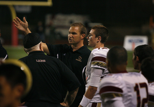 Scott Sommerdorf     The Salt Lake Tribune              Oaks Christian QB Luke Falk gets some instruction from the coaching staff on the sidelines during their 31-21 loss to Bellevue (WA) Wolverines, Saturday, September 3, 2011.