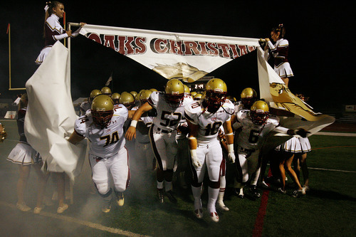 Scott Sommerdorf     The Salt Lake Tribune              The Oaks Christian (CA) Lions burst through a banner as they take the field to play the Bellevue (WA) Wolverines in the Mission Viejo Football Classic in Mission Viejo, California, Saturday, September 3, 2011. Oaks Christian lost the game, 31-21.