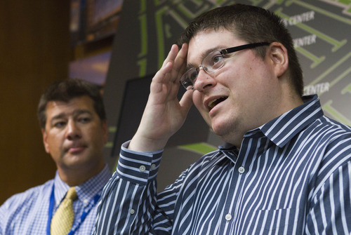 Hospital spokesman Jess Gomez, left, and Tyler Riggs talk about Riggs' nephew Brandon Wright Tuesday Sept. 13, 2011, at Intermountain Medical Center in Murray, Utah. Bystanders in Utah are being lauded as heroes after they lifted a burning BMW off an unconscious motorcyclist, Brandon Wright, trapped beneath it. (AP Photo/Jim Urquhart)