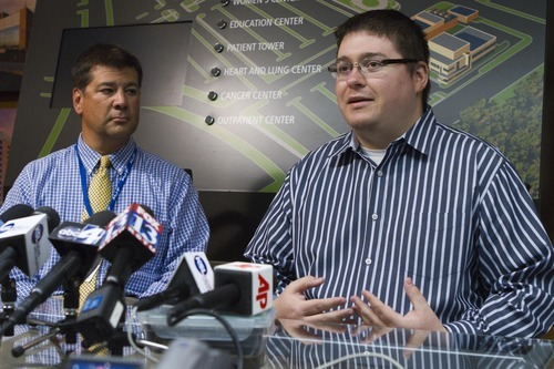 Hospital spokesman Jess Gomez, left, and Tyler Riggs talk about Riggs' nephew Brandon Wright Tuesday Sept. 13, 2011, at Intermountain Medical Center in Murray. Bystanders in Utah are being lauded as heroes after they lifted a burning BMW off an unconscious motorcyclist, Brandon Wright, trapped beneath it. (AP Photo/Jim Urquhart)