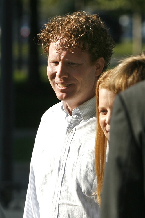 Rick Egan  | The Salt Lake Tribune file photo  Jeremy Johnson smiles as he is greeted by relatives and is released on bail from the federal courthouse in Salt Lake City in September.  Johnson was arrested over the weekend over an unpaid debt to a Las Vegas casino.