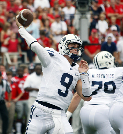 BYU quarterback Jake Heaps (9) throws a first half pass against Mississippi in their NCAA college football game at Vaught-Hemingway Stadium, Saturday, Sept. 3, 2011, in Oxford, Miss. BYU won 14-13. Heaps completed 24 of 38 passes for 225 yards, one touchdown and one interception. (AP Photo/Rogelio V. Solis)