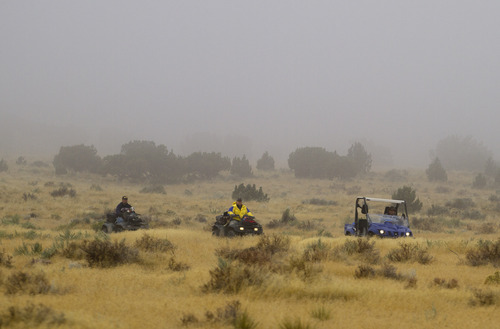Investigators use all-terrain vehicles near the base of Topaz Mountain as law enforcement is looking for missing Utah mother Susan Powell, on Saturday, Sept. 17, 2011, 50 miles northwest of Delta, Utah. Powell disappeared from her West Valley City home in December 2009 and hasn't been seen since. (AP Photo/Jim Urquhart)