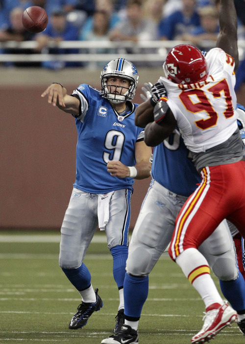 Detroit Lions quarterback Matthew Stafford (9) throws during the first quarter of an NFL football game against the Kansas City Chiefs in Detroit, Sunday, Sept. 18, 2011. (AP Photo/Carlos Osorio)