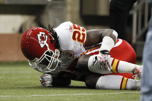 Kansas City Chiefs running back Jamaal Charles (25) grabs his leg after being injured on a play in the first quarter of an NFL football game against the Detroit Lions in Detroit, Sunday, Sept. 18, 2011. (AP Photo/Rick Osentoski)