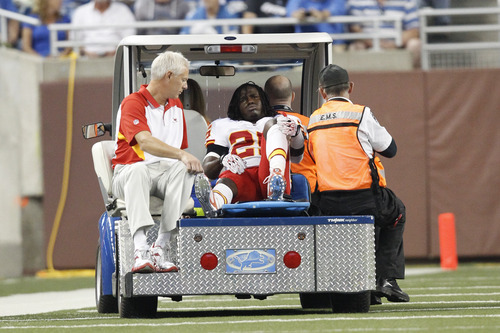 Kansas City Chiefs running back Jamaal Charles (25) is carted off the field after being injured in the first quarter of an NFL football game against the Detroit Lions in Detroit, Sunday, Sept. 18, 2011. (AP Photo/Rick Osentoski)