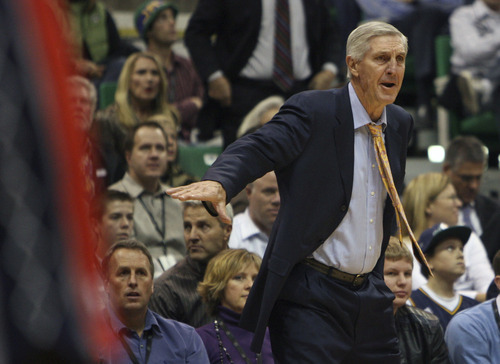 Steve Griffin     The Salt Lake Tribune file photo   Utah head coach Jerry Sloan yells instructions to his team during first half action of the Utah Jazz versus New Jersey Nets basketball game at EnergySolutions Arena in Salt Lake City in November. Sloan stepped down as head coach in February.