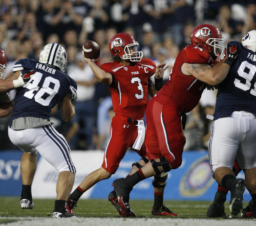 Trent Nelson | The Salt Lake Tribune  Utes quarterback Jordan Wynn (3) drops back to pass during BYU's game against Utah at Lavell Edwards Stadium in Provo, Utah September 17, 2011.