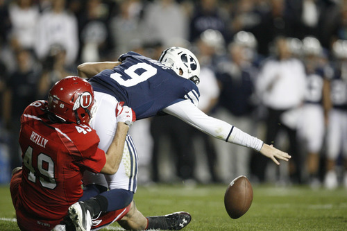 Trent Nelson | The Salt Lake Tribune  Utes linebacker Trevor Reilly (49) causes BYU quarterback Jake Heaps (9) to fumble during BYU's game against Utah at Lavell Edwards Stadium in Provo, Utah September 17, 2011.