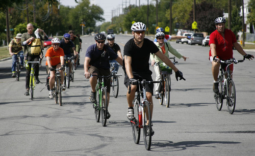 Francisco Kjolseth  |  The Salt Lake Tribune Cyclists follow Becka Roolf, bicycle and pedestrian coordinator for Salt Lake City as she leads a two-hour public tour of Salt Lake City's new and redesigned bikeways. The city says it has added 50 miles to the paths this year.