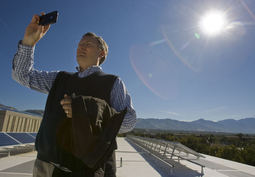 Al Hartmann  |  The Salt Lake Tribune Rocky Mountain Power and The Leonardo unveiled a 30-kilowatt, rooftop solar array that will help power the science, technology and art museum when it opens on Oct. 8.  Salt Lake City Councilman Soren Simonsen takes a picture during a tour of the rooftop array.