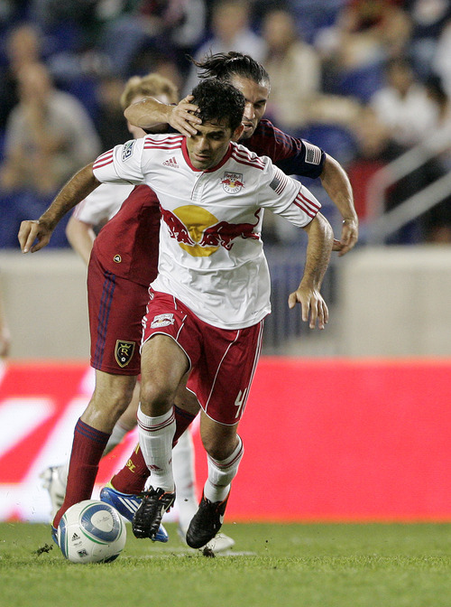 Rich Schultz  |  The Associated Press Real Salt Lake's Fabian Espindola, back, grabs the face of New York Red Bulls' Rafa Marquez (4) as Marquez moves the ball upfield during the first half of an MLS soccer game at Red Bull Arena in Harrison, N.J., Wednesday. Real Salt Lake defeated the Red Bulls 3-1.