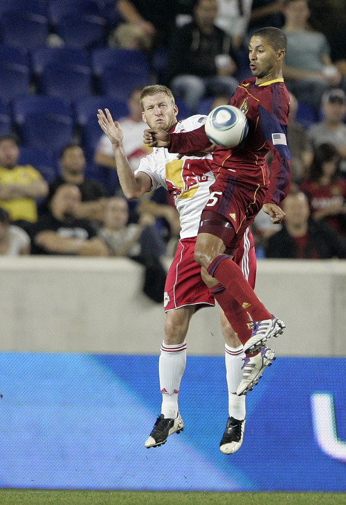 Rich Schultz  |  The Associated Press Real Salt Lake's Alvaro Saborio, right, gets the ball in front of New York Red Bulls' Tim Ream, left, who defends during the first half of an MLS soccer game at Red Bull Arena in Harrison, N.J., Wednesday. Real Salt Lake defeated the Red Bulls 3-1.