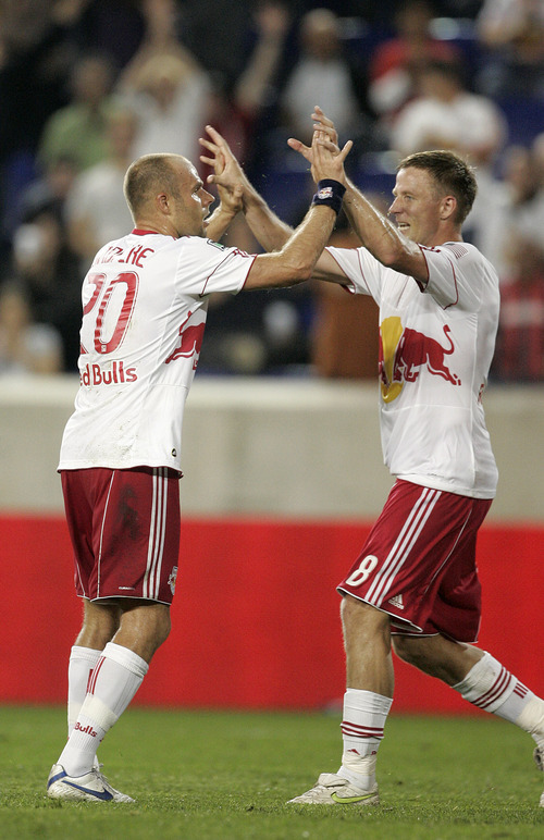 Rich Schultz  |  The Associated Press New York Red Bulls' Joel Lindpere (20) celebrates his goal with teammate Jan Gunnar Solli (8) during the second half of an MLS soccer game against Real Salt Lake at Red Bull Arena in Harrison, N.J., Wednesday.