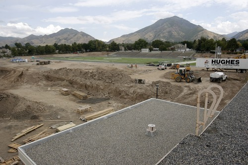 Rick Egan  | The Salt Lake Tribune   View of the new football field, and construction of the new Olympus high school from the roof of the existing building, Friday, September 16, 2011. Olympus High is being rebuilt on the site of the old school while students are in the old building