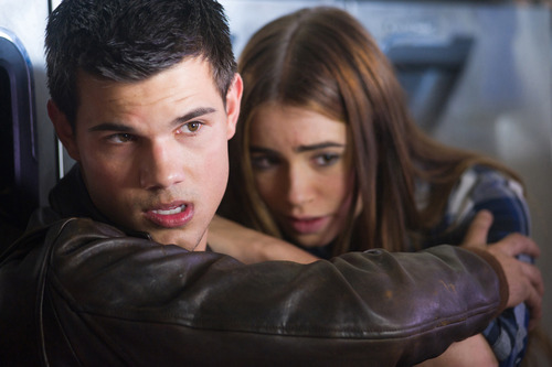 In this film image released by Lionsgate, Taylor Lautner, left, and Lily Collins are shown in a scene from