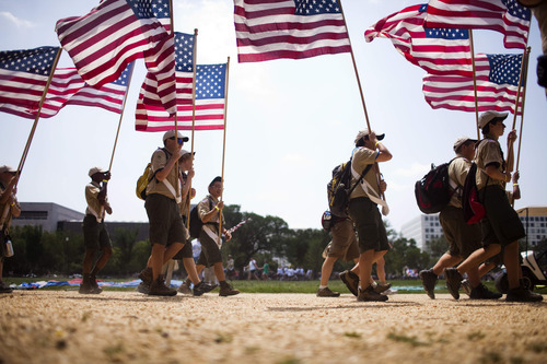 File Photo |  The Associated Press The annual Friends of Scouting fund drive in Utah has stirred some controversy in one LDS Stake because a local leader in charge of the effort warned members that the money was not staying with the local troop and was helping fuel big salaries for top officials.  This file photo shows Boy Scouts marching in formation on the National Mall in Washington, D.C.