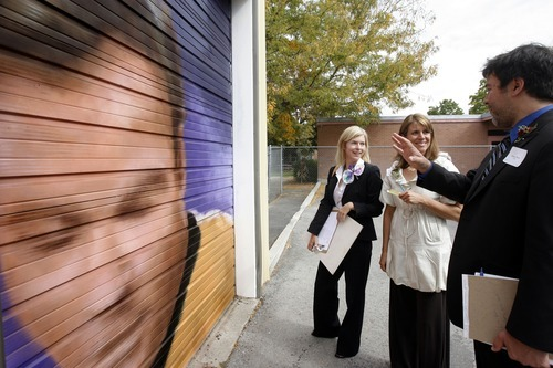 Rick Egan  |  The Salt Lake Tribune Adam Price (right) discusses a garage door painted by Joseph Thomas, with Lisa Eccles (left) and Carol Firmage (center), Oct. 3, 2008. The garage doors, which are part of the 337 Project's Urban Gallery, a set of garage doors painted by 337 artists on the occasion of the 30th anniversary of the nonprofit organization Neighborhood House.