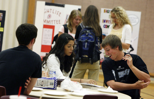 Francisco Kjolseth  |  The Salt Lake Tribune University of Utah students, Sarah Bejarano and Joshua Flygare gather during a Peanut Butter and Jelly social at the Institute of Religion on campus to get kids signed up for classes on Tuesday, August, 30, 2011. Over the summer the LDS Church disbanded its fraternities and sororities at the University of Utah.