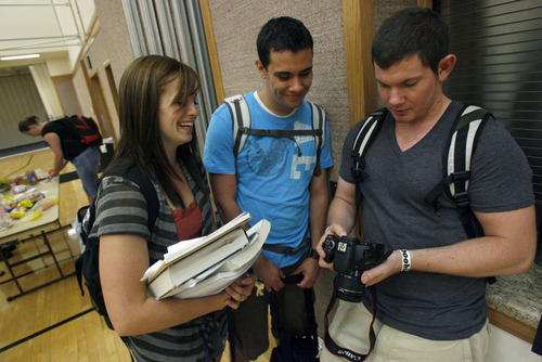 Francisco Kjolseth  |  The Salt Lake Tribune University of Utah students, Kara Vickers, Jordan Nielson and Abraham Braten, from left, look over pictures recently during a social gathering at the Institute of Religion on campus where students were busy catching up and signing up for classes. Over the summer the LDS Church disbanded its fraternities and sororities at the University of Utah, prompting students to find other social avenues to serve and meet other students.