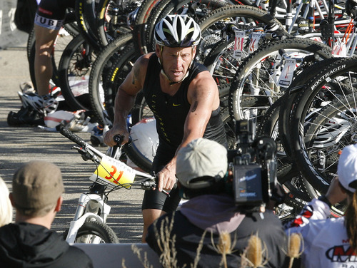 Scott Sommerdorf  |  The Salt Lake Tribune              Lance Armstrong transitions from swimming to the bicycle leg of the 2011 XTERRA Nationals held at Snowbasin, Saturday, September 24, 2011. Armstrong finished fifth with a time of 2:29.25.