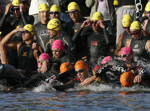 Scott Sommerdorf  |  The Salt Lake Tribune              Lance Armstrong, (lower center in orange cap), dives into Pineview Reservoir to begin the first leg of the 2011 XTERRA Nationals held at Snowbasin, Saturday, September 24, 2011.