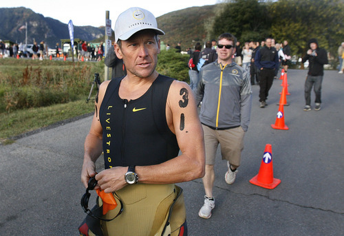 Scott Sommerdorf  |  The Salt Lake Tribune              Lance Armstrong heads for the starting line at Pineview Reservir to begin the 2011 XTERRA Nationals held at Snowbasin, Saturday, September 24, 2011. Armstrong finished fifth with a time of 2:29.25.