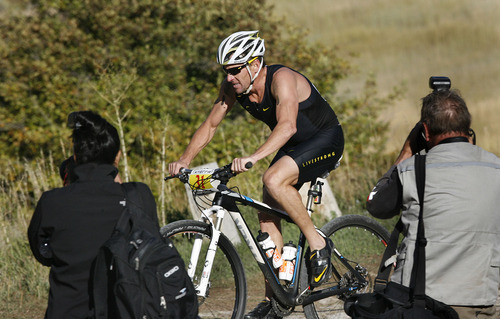 Scott Sommerdorf  |  The Salt Lake Tribune              Lance Armstrong on the second leg of the 2011 XTERRA Nationals held at Snowbasin, Saturday, September 24, 2011. Armstrong finished fifth with a time of 2:29.25.