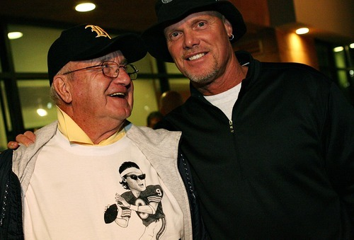 Djamila Grossman  |  The Salt Lake Tribune  Former NFL football star Jim McMahon poses for a portrait with his father, Jim F. McMahon, in Layton, Utah, on Friday, Sept. 16, 2011. Father and son were in Utah to attend a ceremony at Roy High to retire Jim McMahon's jersey, No. 9.