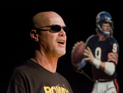 Al Hartmann  |  The Salt Lake Tribune Jim McMahon, former Roy High School graduate addresses students  gathered Friday morning for a pep rally September 16.   He went on to quarterback for BYU and the Chicago Bears in the NFL.   His jersey will be retired Friday night during a game with Box Elder High School.