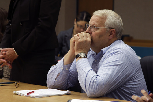 Chuck Cox, the father of missing Utah woman Susan Powell, sits in a Pierce County courtroom, Friday, Sept. 23, 2011, in Tacoma, Wash. Cox was attending a hearing seeking an injunction to keep his son-in-law, Josh Powell, from publishing portions of Susan Powell's journals. (AP Photo/Ted S. Warren)