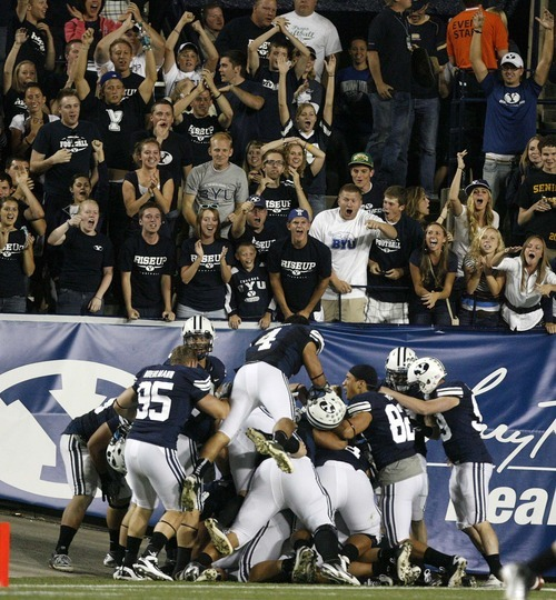 Trent Nelson  |  The Salt Lake Tribune BYU players and fans celebrate a score that was called back on a third quarter punt. BYU vs. Central Florida, college football at LaVell Edwards Stadium in Provo, Utah, Friday, September 23, 2011.
