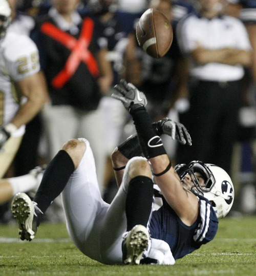 Trent Nelson  |  The Salt Lake Tribune BYU's McKay Jacobson watches a pass bounce off of him in the third quarter. BYU vs. Central Florida, college football at LaVell Edwards Stadium in Provo, Utah, Friday, September 23, 2011.