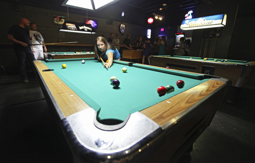 Lennie Mahler  |  The Salt Lake Tribune Melissa Snee shoots on a pool table in the recently-expanded area of Sugar House Pub.