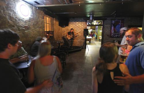 Lennie Mahler  |  The Salt Lake Tribune Matt Bolton performs at Sugar House Pub in August.