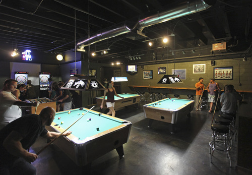 Lennie Mahler  |  The Salt Lake Tribune Sugar House Pub features two barsand a gaming area.