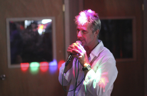 Lennie Mahler  |  The Salt Lake Tribune Wade Neff sings at the Highlander Club karaoke bar, 6194 South and Highland Drive, on Aug. 26. The bar features nightly karaoke with two practice booths and a 65,000-song catalog.