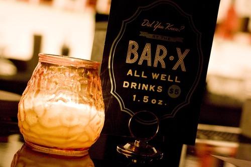 Djamila Grossman  |  The Salt Lake Tribune A sign sits on the bar of Bar-X in downtown Salt Lake City.